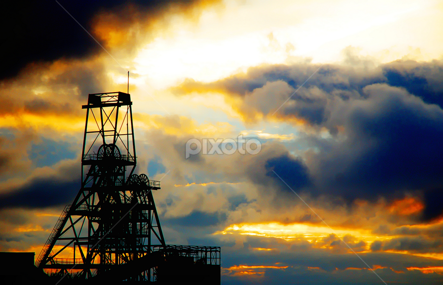 South Crofty tin mine by Aaron Nappin - Buildings & Architecture Other Exteriors ( clouds, mining, structure, building, cornish, tin, sun, cornwall, heritage, gear, metal, sunset, beam, mine )