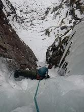 Photo: Simon negotiates the ice shroud on Turqoise Gully (III)