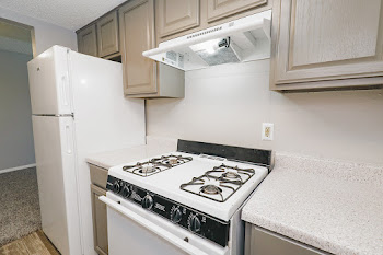 B2 kitchen with gray cabinets and white appliances