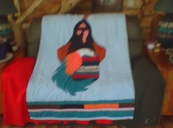 free hand indian shadow quilt with large bird and wolves. I made for my dad