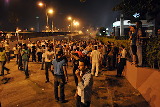 Photo: Protesters, Muslim and Christian alike, gather outside the Ramses Hilton Hotel near where the violence broke out...