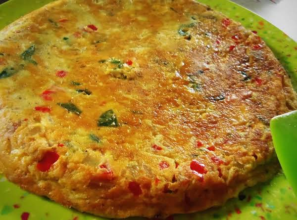 Spanish Style Tortilla With Queso Panela And Baby Spinach