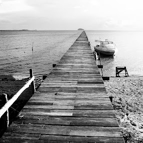 a jetty from an island by Pungut Luntar - City,  Street & Park  Vistas