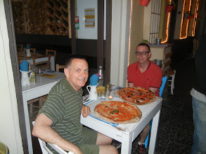 Photo: ... and were served two of the largest pizzas I'd ever seen. (In Italy, everyone gets their own individual pizza, so these were not to be shared by two or three people).   They were great, and (needless to say) we both finished them off.