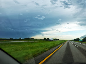 Photo: Driving along I-80, heading west. There were thunderstorms in Lincoln as we left in the early morning. Would that storm on the left follow us?