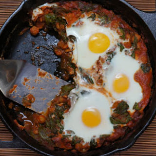 Eggs Over Spinach, Chickpeas and Tomato Sauce.