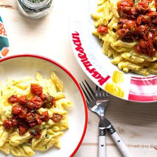 Penne Ricotta, Saffron and Cherry tomatoes confit.