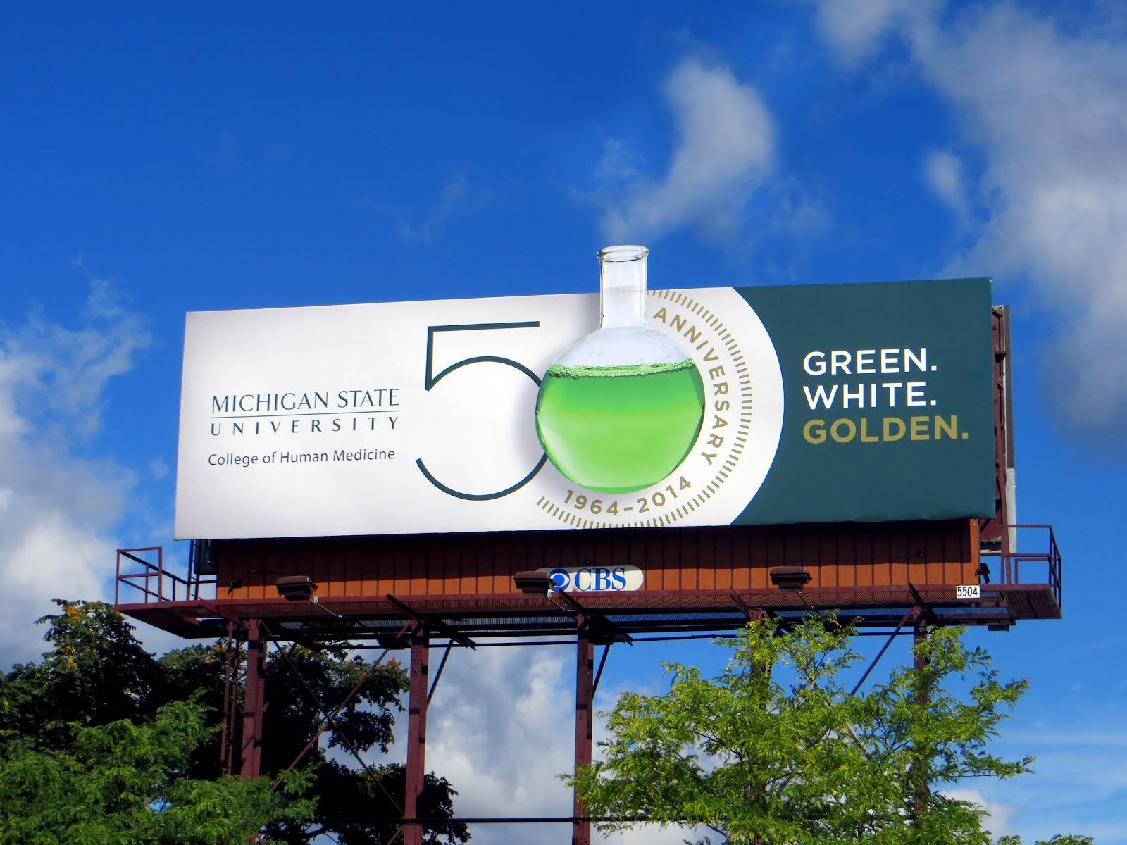 billboard by Michigan State University celebrating 50 years