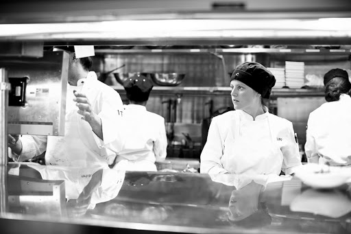 Behind-the-scenes look at the kitchen with a kitchen partner looking at the order screen
