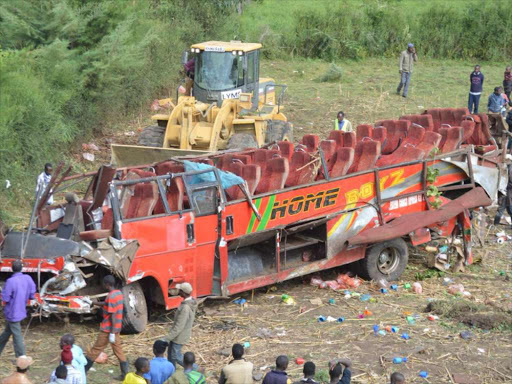 The scene where a Kakamega bound bus rolled killing 58 people on Wednesday morning. COURTESY