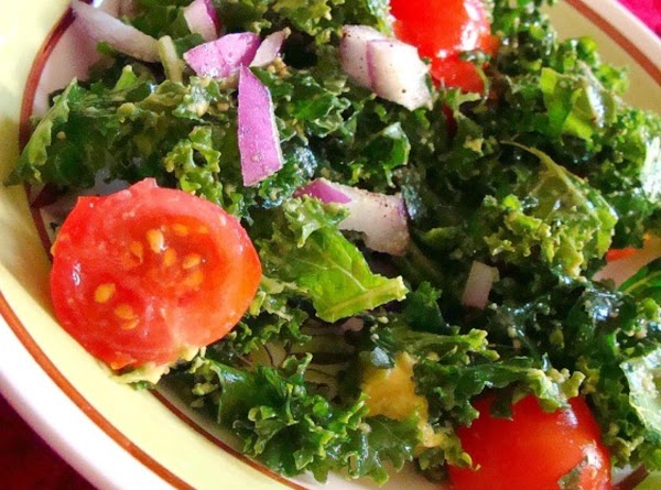 In a large bowl, add kale pieces oil and salt. With clean hands, massage...