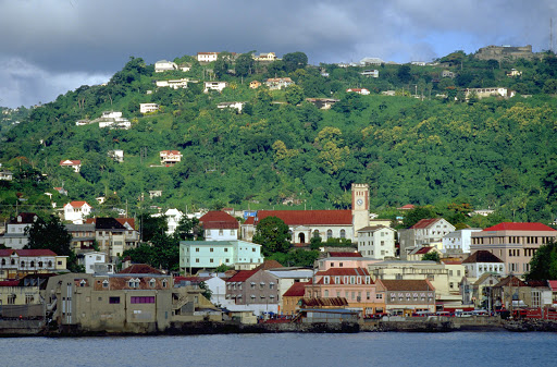 St. George's, capital of Grenada, is a picturesque city of of stone buildings and red-tile roofs.