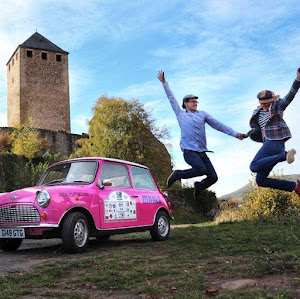 The Pink Mini gets stuck on a cliff by a castle while the Italian Police push her free | Krys Kolumbus Travel Blog