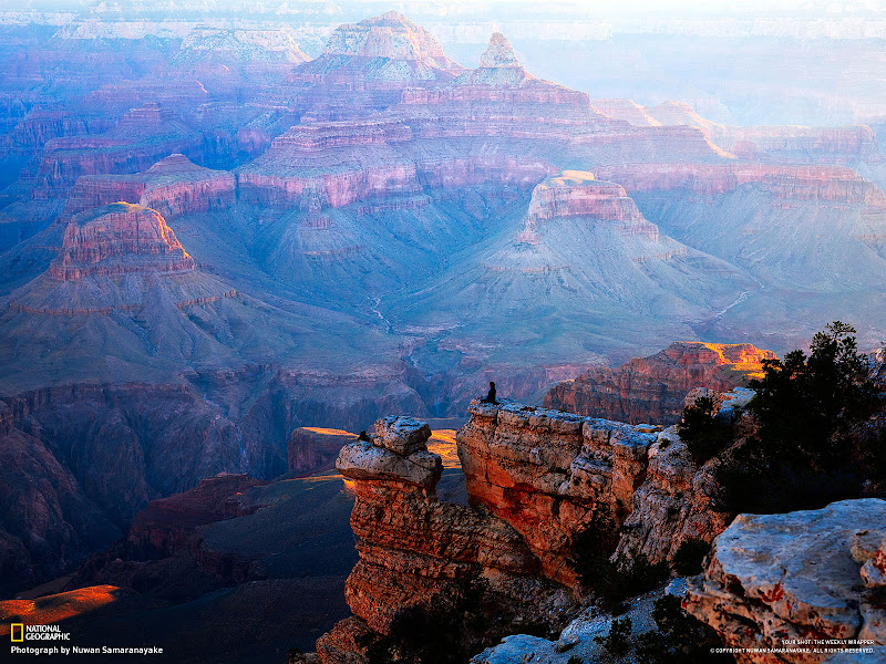 Photo: This photograph was taken at Yavapai Point on the Grand Canyon Southern Rim during the sunrise. While I was photographing the sunrise, a man with a black robe climbed down to this narrow rock cliff, did some exercises and started to meditate. It was a breathtaking view that I wanted to capture, with the vastness of the Canyon's landscape, the warmth of the sunrise, and the focus of this man doing his meditation. Photo and caption by Nuwan Samaranayake
