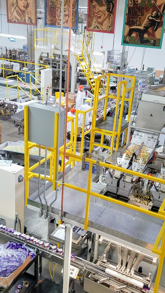 Jelly Belly Factory Tour in Fairfield, California: man and machine working together to make Jelly Belly into production and sale