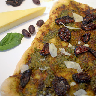 Pesto Pizza with Sun-Dried Tomato and Asiago Cheese.