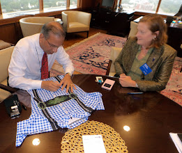 "Photo: Reception 18th floor at RI President´Office with Ravi Ravindran, Signing the presented ""Alpine Cycling Jersey. Thanks to Kristin Brown, for her Support Meeting the Rotary International Heads."