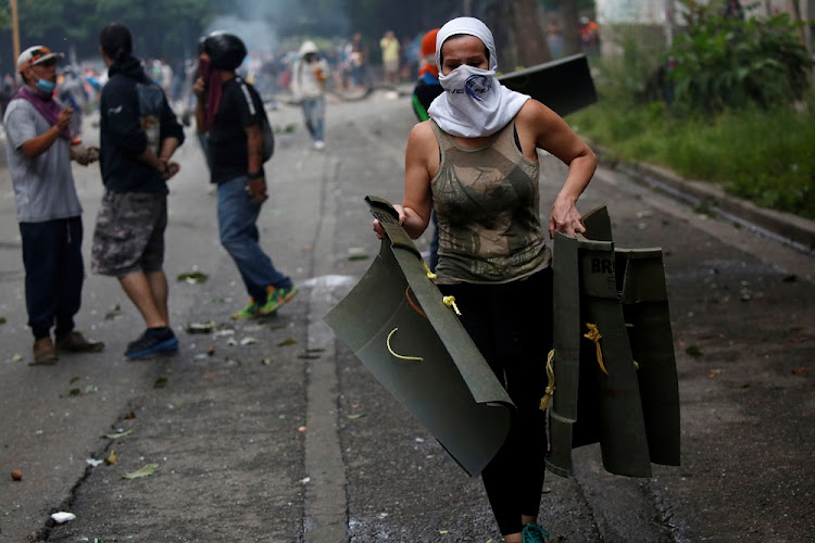 A demonstrator carries homemade shields during clashes with riot security forces during a strike called to protest against Venezuelan President Nicolas Maduro's government in Caracas, Venezuela.    File picture: REUTERS