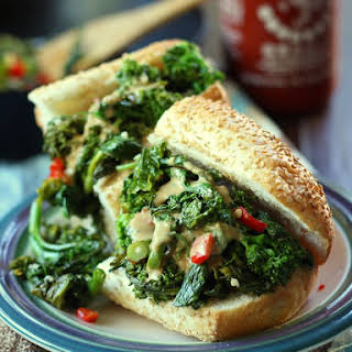 Hot Garlicky Broccoli Rabe Sandwich with Smoky Tahini Cheese Sauce.