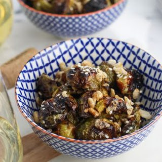Crispy Brussels Sprouts with Sesame Glaze and Puffed Rice.