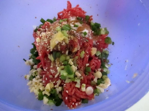 Place all ingredients in a medium bowl, using clean hands or a spatula, toss...