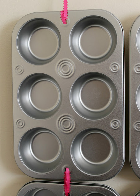 Connect muffin tins with ribbon for a DIY advent calendar