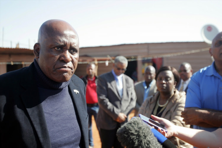 The then Hawks boss Berning Ntlemeza when he visited a family after four of their relatives were shot dead at the Lawley informal settlement in Johannesburg in August 2016.