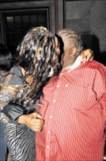 KISSING COUSINS: Gay socialite Iko Mash and gospel and gospel star Nkanyiso Bhengu locked lips.  Cicra 2008. Pic. Unknown.
