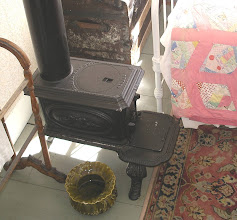 Photo: A bedroom stove from a Victorian inn. Willowbrook Village, Maine. Oh yes, and what seems to be a spitoon.