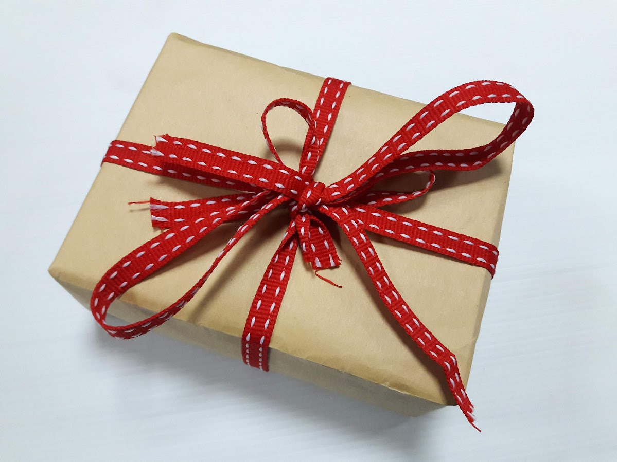 Gift Wrapped With a Used Envelope - Recycling Envelopes
