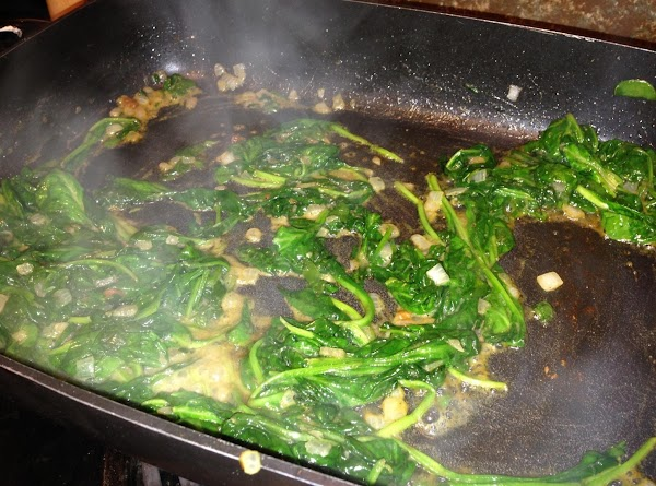 Add Spinach and the mushrooms, cook til sauteed, add salt and pepper,scoop into pie...