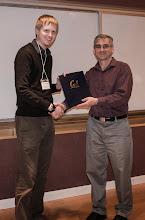 Photo: Michael Eggleston accepting the Ross N. Tucker Memorial Award.