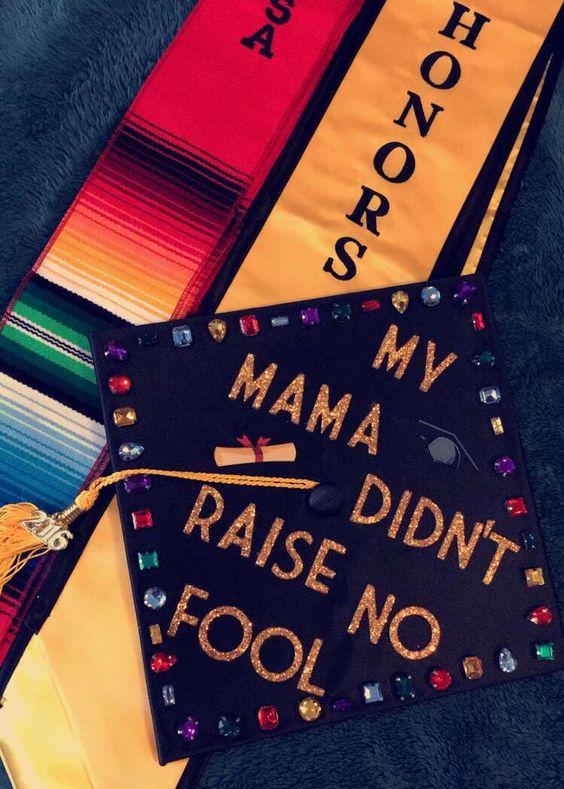 "A graduation cap that reads ""My mama didn't raise no fool."""