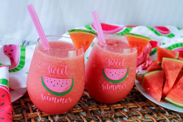 Watermelon Vodka Slushes In A Glass With A Wedge Of Watermelon.