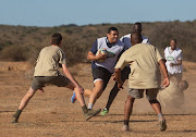 Land Rover, official Worldwide Partner of Rugby World Cup 2019TM, staged a bush rugby match with Rugby World Cup 2007 winner Bryan Habana and former New Zealand player Justin Marshall at Kwande Private Game Reserve on August 21, 2019 in Port Elizabeth, South Africa.