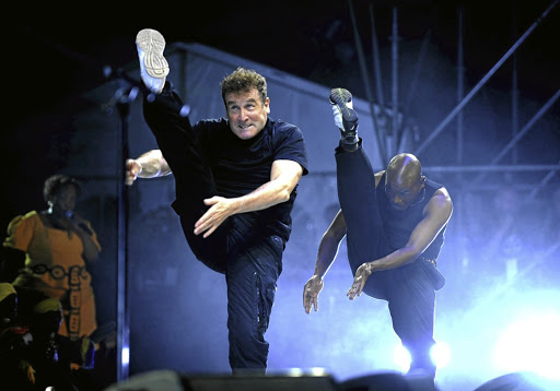 Johnny Clegg performs isicathamiya zulu dance./Tsheko Kabasia