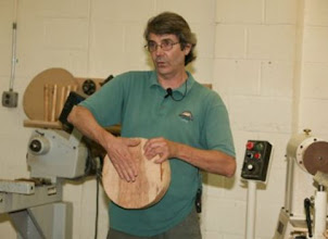 Photo: For the demonstration, Alan turned a seat and a leg for a miniature stool. He showed his technique for creating the seat.