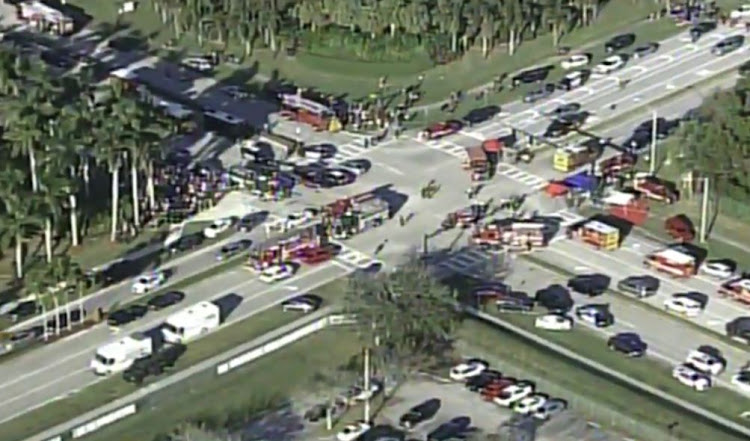 Police and rescue workers attend the scene near Marjory Stoneman Douglas High School following a shooting incident in Parkland, Florida, U.S. February 14, 2018 in a still image taken from a video.