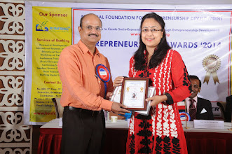 Photo: Chief Guest Mr. A. Devi Dutt Issuing Senior Woman Entrepreneur Award to Ms. Indrani Mukherjee, Managing Director, Bambooz, Bangalore, Karnataka
