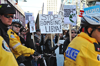 Photo: Surrounded by police officers, a strong anti-war contingent attended the demonstration to call on the Canadian government to stop bombing Libya, and to bring home all the troops from Afghanistan.