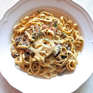 Fettuccine Tossed In A Marsala Cream Sauce With Smoked Pork Belly And Mushrooms.