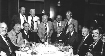 Photo: standing: Bill Robinson, George Wild, Bunny Stotesbury, Ed Schoenherr, Jake Klassen; seated: Warren Jeffrey, Len Greenough, John McCaughey, Stan Bullis, Roy Soderland, Peter Place, John Green