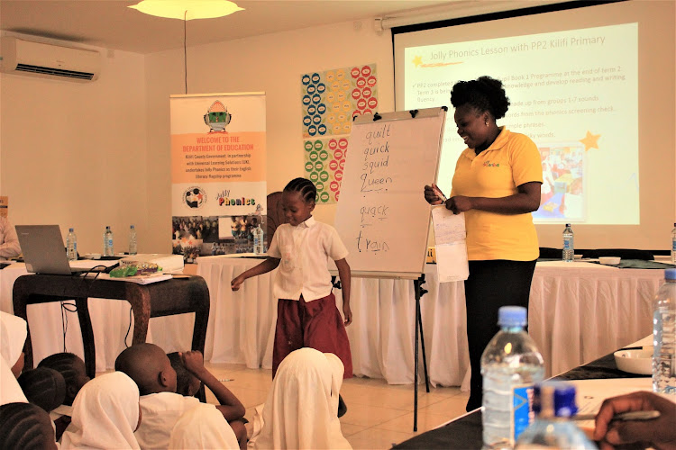 Jackline Karisa of Kilifi Primary School demonstrates with her PP2 pupils how the Jolly Phonics works during the Jolly Symposium on October 14 in Kilifi