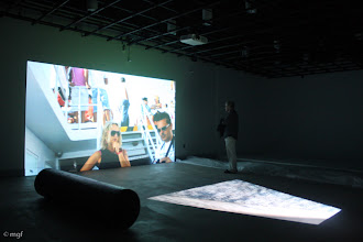 """Photo: Projection of """"Concordia,"""" hd two channel video, 8 min. trt (loop), with pvc tube and plastic sheet, UofC DoVA MFA critique 11/20/12. mgf"""