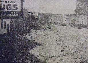 Photo: Debris clutters the street.
