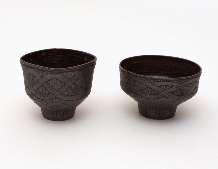 Pair of carved stoneware tea bowls by Chris Carter