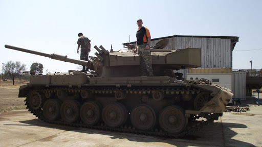 Dr Venter conducting a tour of an Olifant Mk1A Main Battle Tank with members of the South African Army Armour Formation.