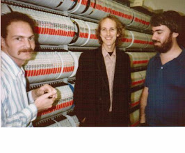 Photo: Tom Valerio, George Helffrich, and Steve Burling in front of the tape racks on the second floor of the academic Computing Center Building on the North Campus of the University of Michigan, Ann Arbor