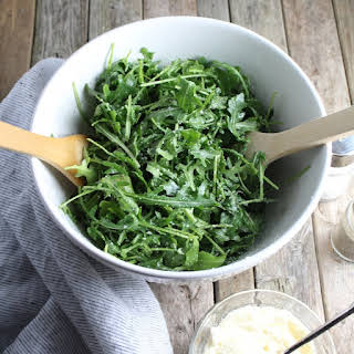 Arugula Salad With Olive Oil, Lemon and Parmesan Cheese.