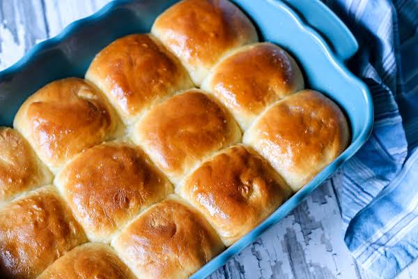 A Baking Dish Filled With Sweet Yeast Rolls.